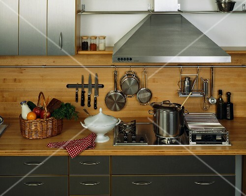 View of a kitchen with various kitchen utensils
