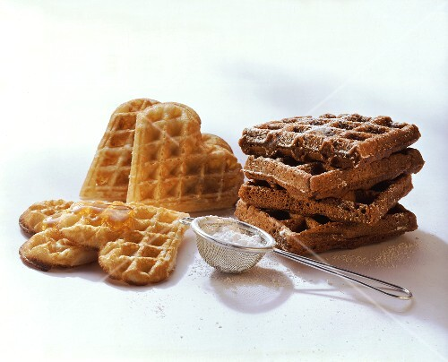 Waffles with icing sugar & chocolate waffles with almonds