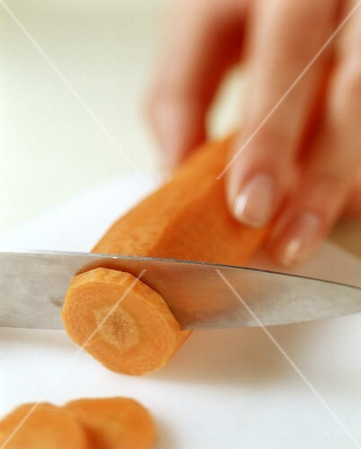 A carrot being sliced