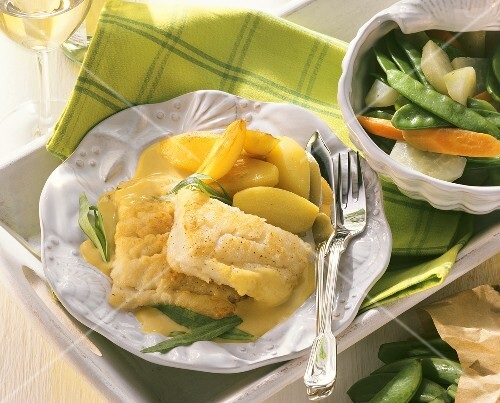 Cod fillets with tarragon sauce, potatoes, mixed vegetables
