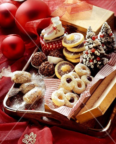 Assorted biscuits in wooden box and on tray