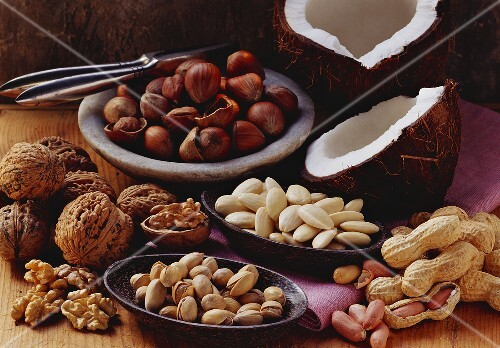 Still life with various nuts and a nut cracker