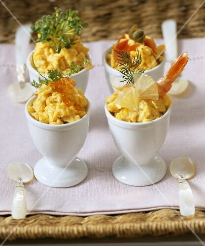Scrambled egg with various toppings in egg cups