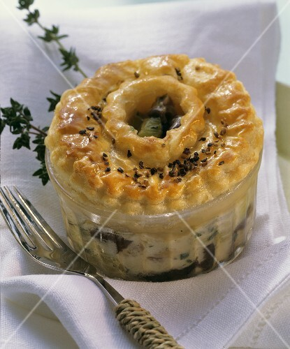 Pie in dish with mushroom ragout and fresh thyme