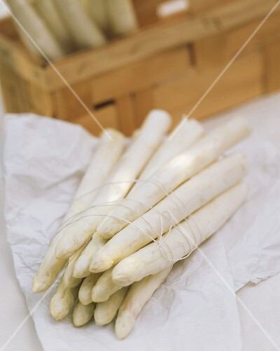 Bundle of white asparagus, & in crate behind