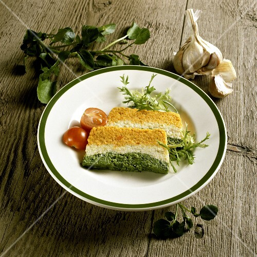 Two slices of vegetable terrine on plate