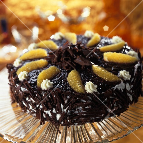 Chocolate cream gateau with blackberry icing & orange segments