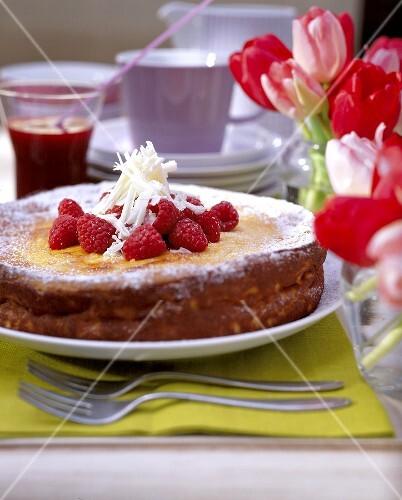 Quark cake with white chocolate and raspberries
