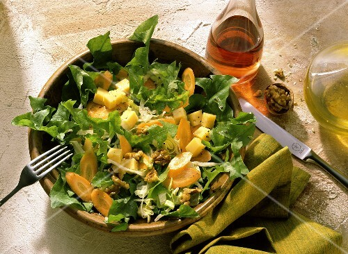 Dandelion salad with cheese, carrots and walnuts