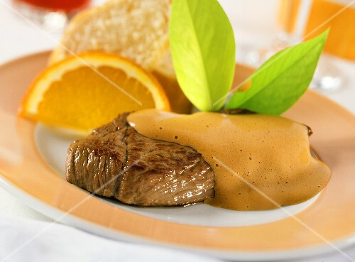 Steaks of young venison with stout zabaione and oranges