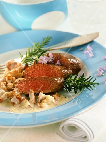 Roast saddle of venison with chanterelles and rosemary