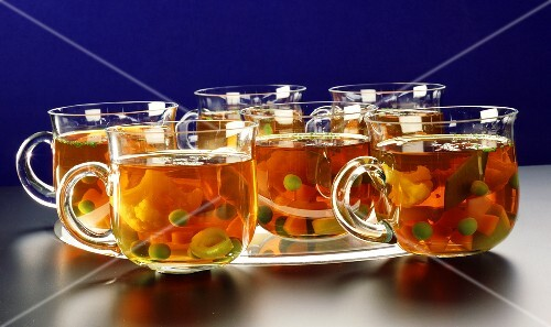 Vegetable broth in glass cups in a microwave