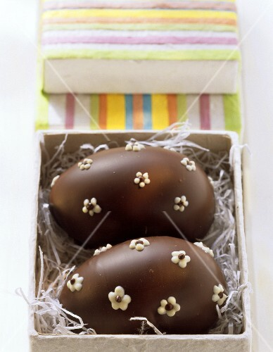 Filled Easter eggs in leavened quark dough with chocolate icing