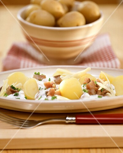 Boiled potatoes with matje herring and cream sauce