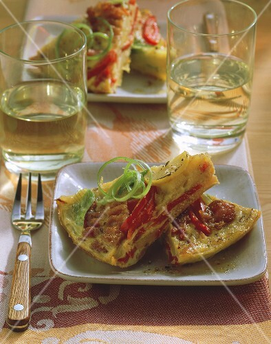 Potato tortilla with bacon, peppers and leeks