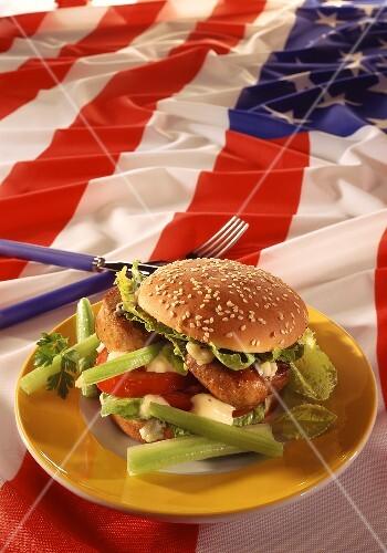 Burger with pork fillet, vegetables & mayonnaise on US flag
