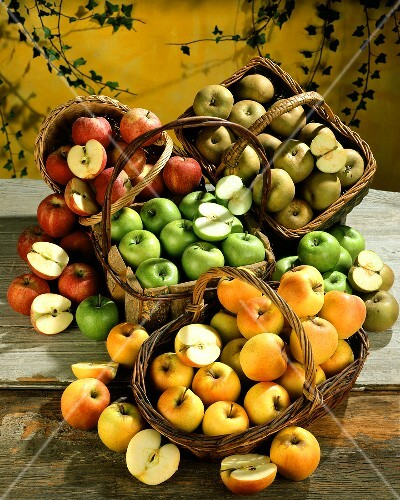 Four baskets of different types of apples
