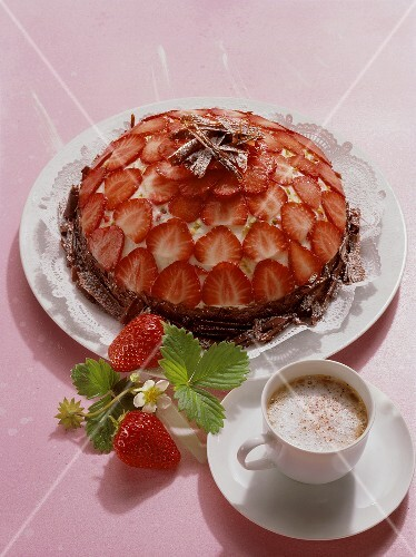 Domed strawberry gateau with chocolate curls