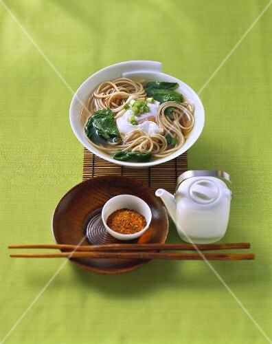 Soup with soba noodles, spinach and poached egg (Japan)