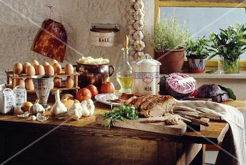 Rustic German kitchen table with ingredients and a roast