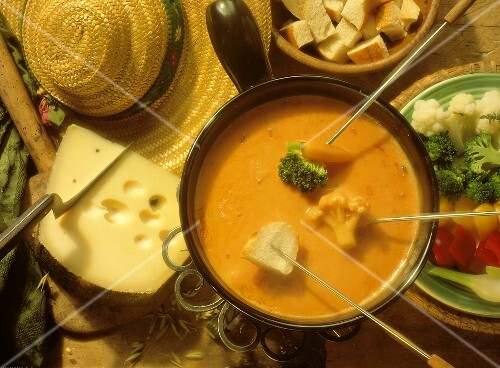Dipping Vegetables and Bread into Cheese and Tomato Fondue
