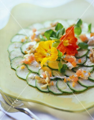 Courgettes with herb mousse and nasturtiums on plate
