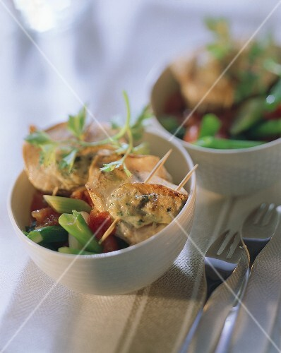 Poultry parcels with wine & mustard sauce & vegetables
