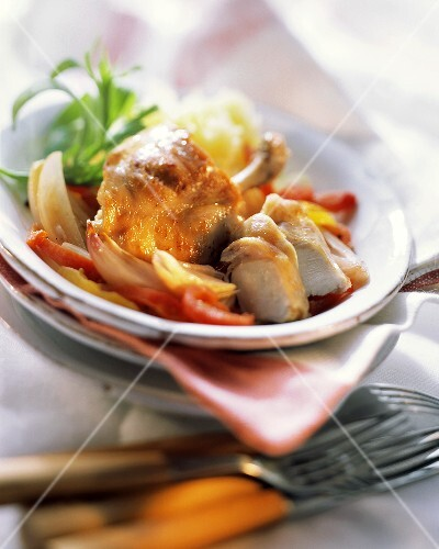 Rabbit in vermouth sauce with peppers & onions