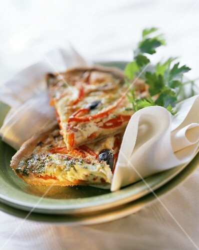Pepper tart with leeks (two pieces on napkin on plate)