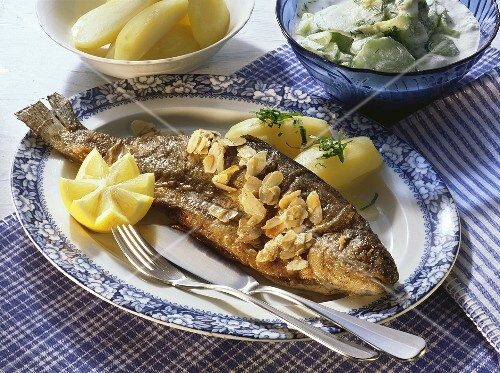 Trout stuffed with herbs and flaked almonds