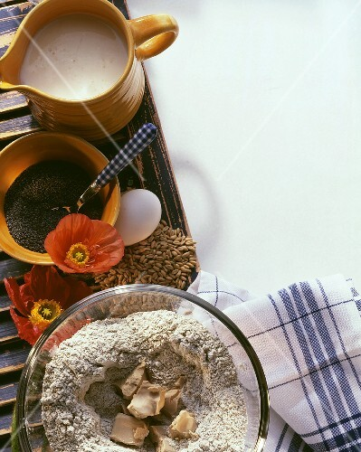 Still life: yeast in flour, poppyseeds, sourdough starter