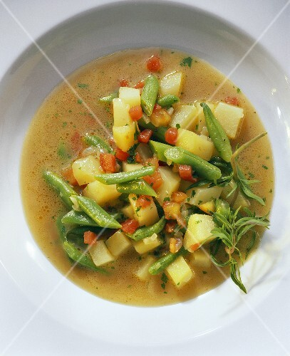 Green bean soup with potatoes, tomatoes & summer savory