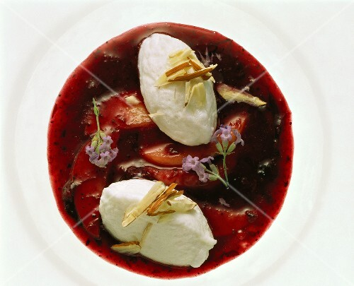 Elderberry soup with poached meringues, apples & flowers