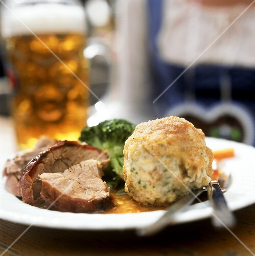 Veal shank with bread dumpling and beer at Oktoberfest