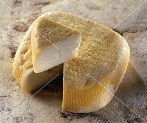Niolo, a Corsican sheep's cheese, on reddish background