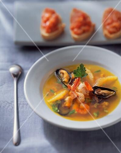 Seafood soup with orange segments