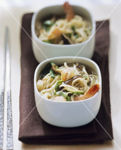 Vietnamese noodle soup with shrimps, spinach and mushrooms