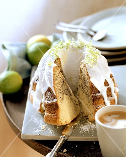 Lime and poppy seed cake with white icing; coffee