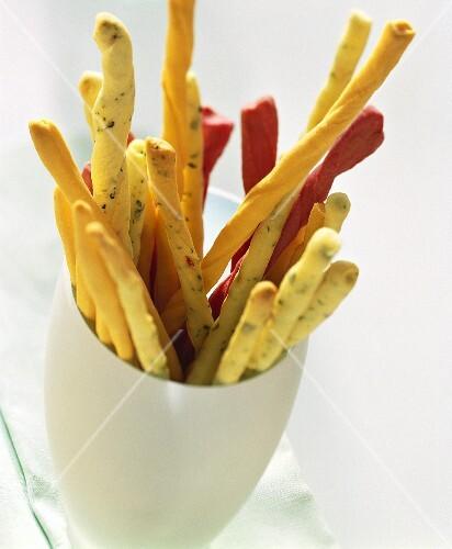 Various party grissini (bread sticks) in beaker