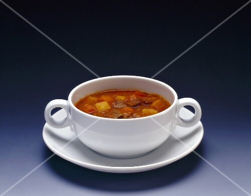 Goulash soup in white soup cup