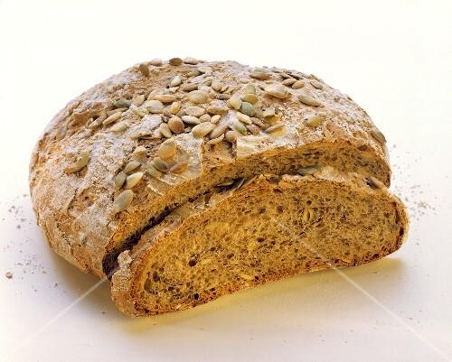 Pumpkin seed bread with a slice cut