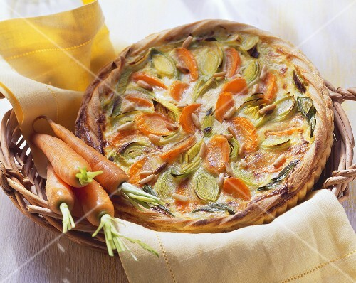Carrot and leek tart with pine nuts; fresh carrots