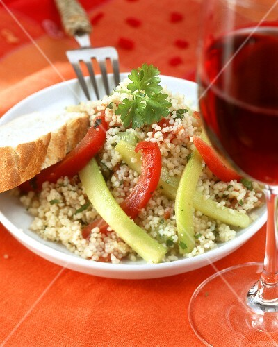 Couscous and vegetable salad with white bread and red wine