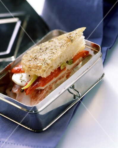 Sandwich with peppers and cheese in a picnic box