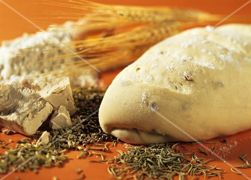 Baking ingredients for bread: yeast, flour, fennel, rosemary;