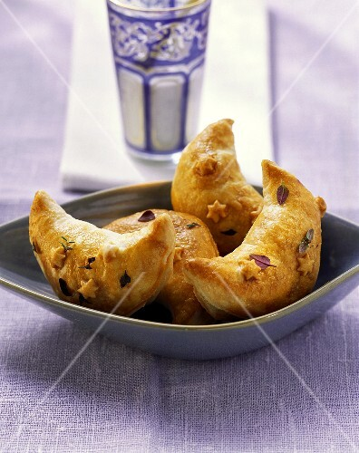 Half-moon shaped pasties with mince filling