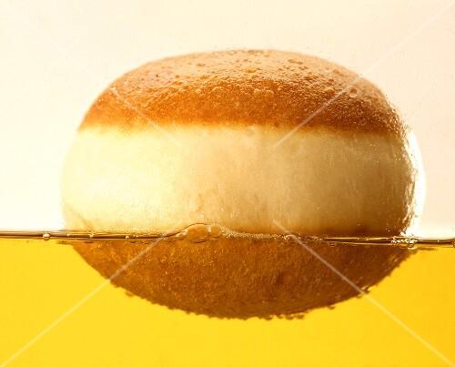 Doughnuts floating in fat