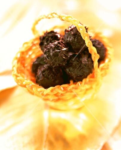 Lemon grass truffles in candied orange basket