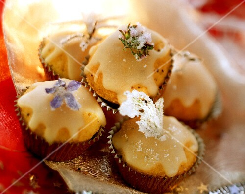 Petit fours with icing and candied flowers