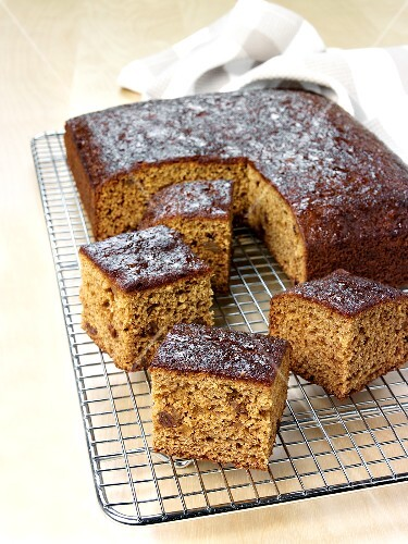 Gingerbread with icing sugar, a piece cut